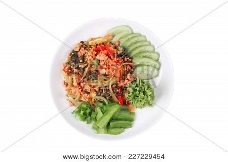 Isolated of Thai popular food,Fried spicy basil with minced pork topped wing bean and sliced cucumber call Pad Kra Prow Moo in Thai. stock photo