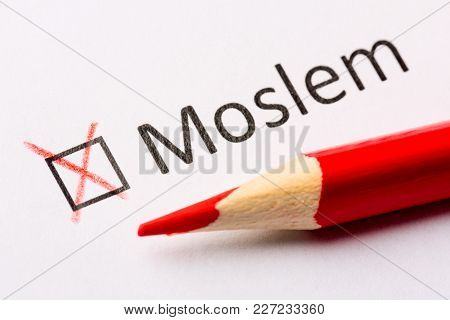 Questionnaire concept. Religious interrogation. Red pencil and the inscription Moslem with cross on white paper. Close up image stock photo