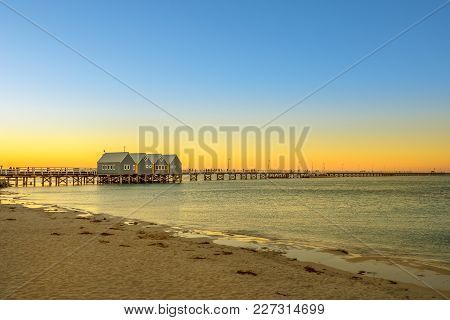 Scenic landscape of iconic Busselton Jetty in Busselton Beach, Western Australia at sunset light. Busselton Jetty is the longest wooden pier in the world. Copy space. stock photo