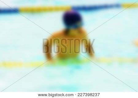 Blurred image of people relaxing at swimming pool - recreational background concept stock photo