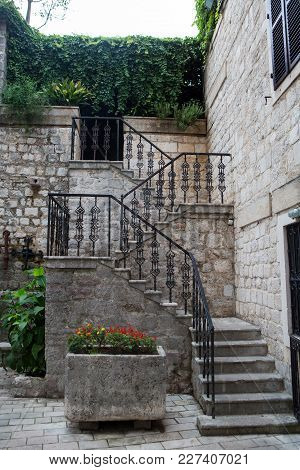 staircase with iron railings and flowers in Montenegro in Kotor stock photo