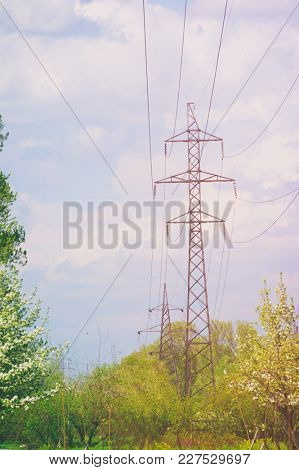 High-tension power line with clouds stock photo