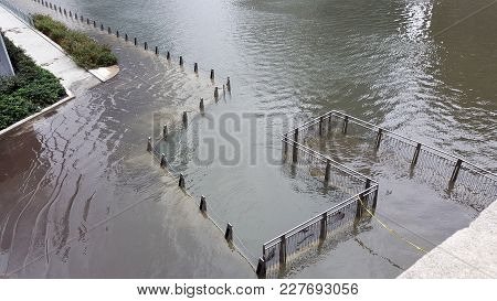 Pedestrian Walkway river walk along the Chicago River flooded and inundated with water from a recent rain storm, overflowing banks stock photo
