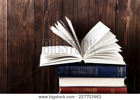 Old books on wooden background. The source of information. Books indoor. Home library. Knowledge is power stock photo