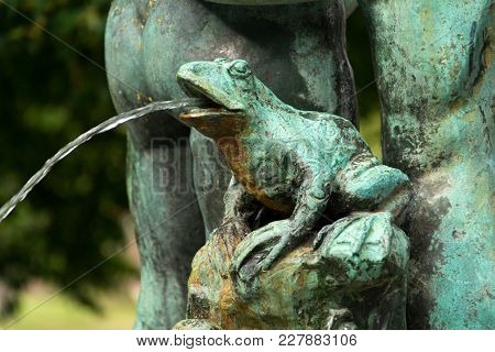 Frog splashing water on fountain, water scarcity concept, Petrin, Prague stock photo