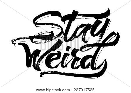 Stay Weird. Modern Calligraphy Hand Lettering for Silk Screen Printing stock photo