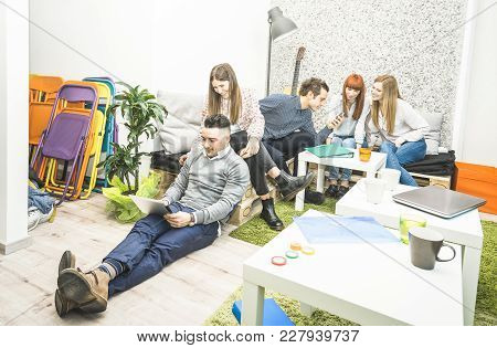 Young people employee workers having break in start up office - Human resources business concept with creative entrepreneurs having fun together to recover productive energy - Neutral location filter stock photo