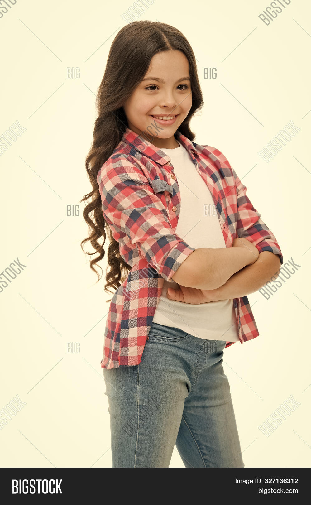 Kid girl long curly hair posing confidently. Girl curly hairstyle smiling face feels confident. Child hold hands confidently crossed chest. Upbringing confidence. Feel so confident with new hairstyle.