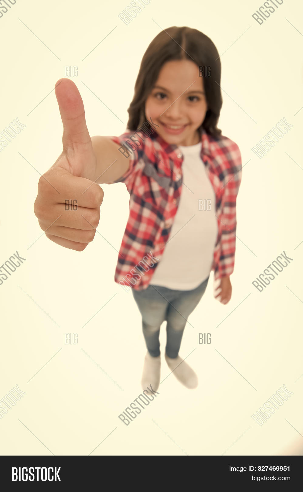 Kid girl long curly hair posing confidently. Girl smiling face feels confident. Child confidently showing thumbs up. Upbringing confidence concept. Feel so confident with parental support. I like it.