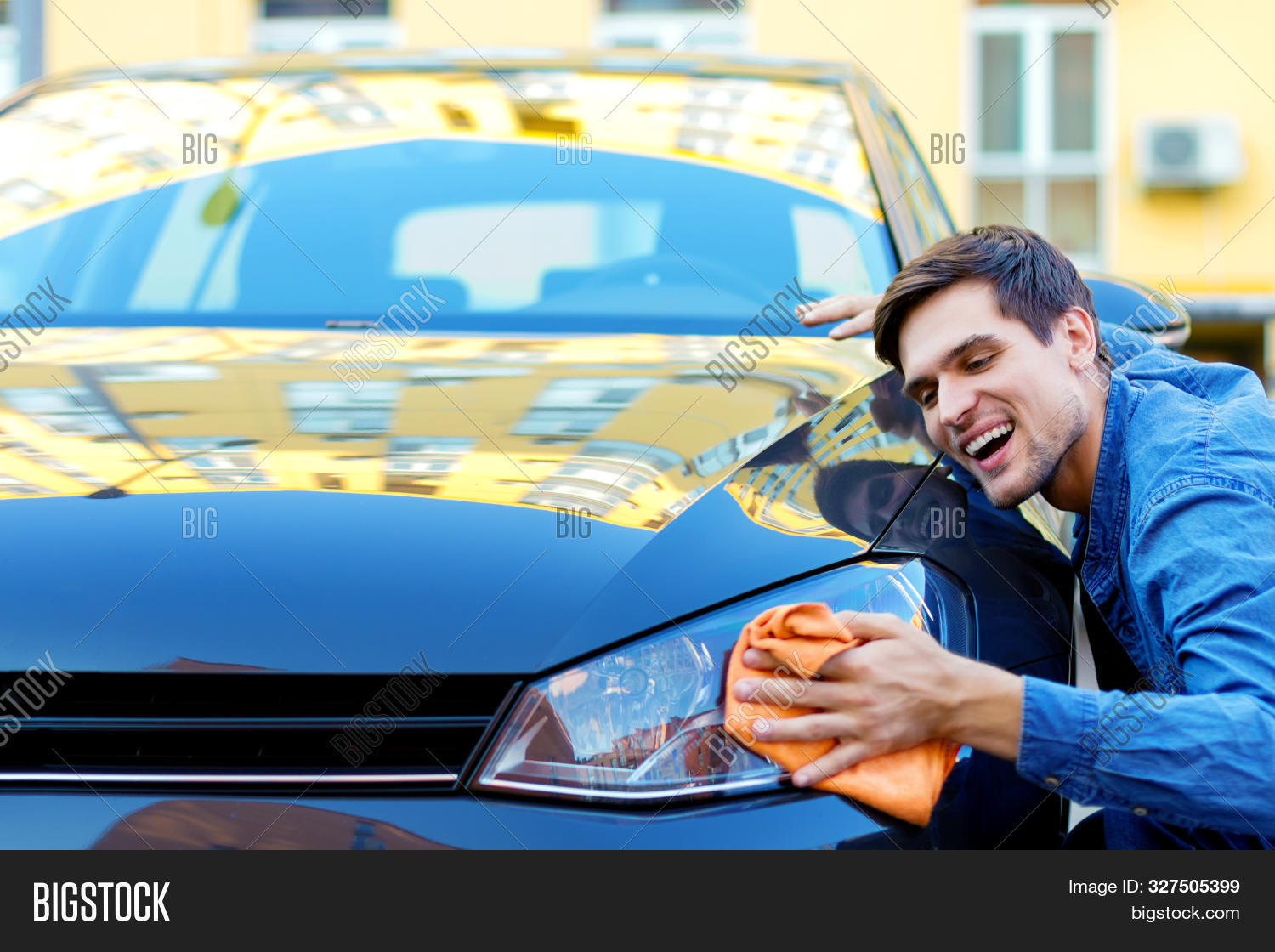 adult,auto,automobile,black,brunette,buying,car,casual,caucasian,cheerful,city,cleaning,concept,customer,denim,drive,driver,hand,happy,holding,hugging,lifestyle,love,luxury,machine,male,man,modern,new,orange,owner,people,person,purchase,rag,relationship,road,service,shirt,single,smiling,street,stroking,transport,transportation,travel,vehicle,wiping,work,young