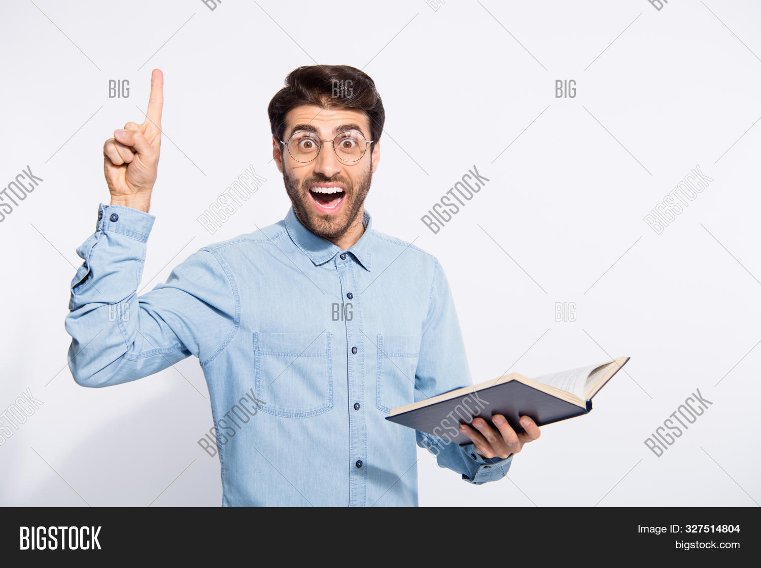 Photo Of Multiethnic Clever Guy Holding Planner Indicating Finger On Black Board Explaining Students