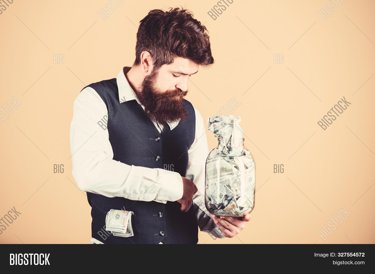 accountant,as,bank,banking,bearded,benefit,budget,business,businessman,cash,concept,currency,dollar,early,economy,entrepreneur,establish,finance,financial,formal,full,fund,guy,his,hold,jar,keep,loan,man,manager,money,possible,profit,retirement,rich,safety,saving,security,start,successful,suit,transaction,tux,work,your