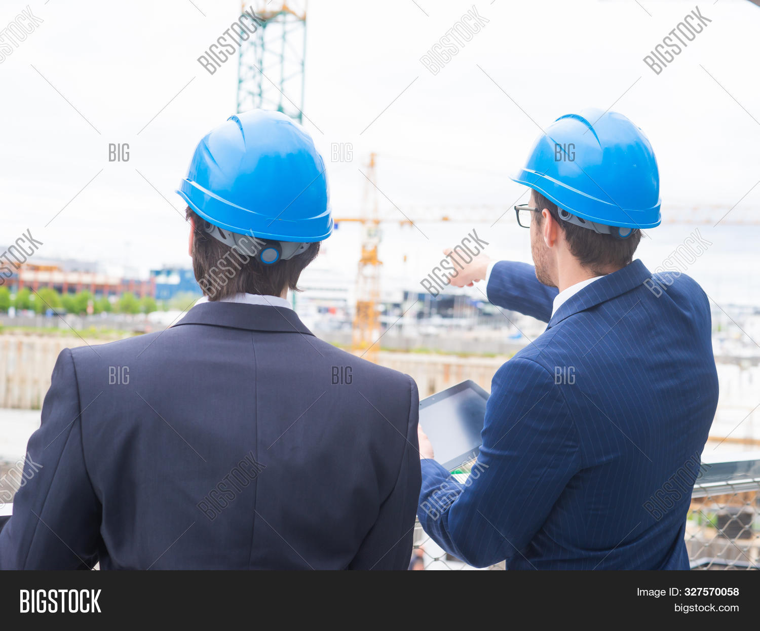 Business,architect,balcony,bank,banking,building,businessman,businessperson,career,city,collar,colleagues,communication,company,concept,confident,construction,conversation,corporation,coworkers,crane,deal,development,financial,formalwear,future,helmet,invest,job,mail,manager,market,men,modern,office,outdoor,outside,partners,people,person,perspectives,professional,retailing,standing,talking,white,worker,young