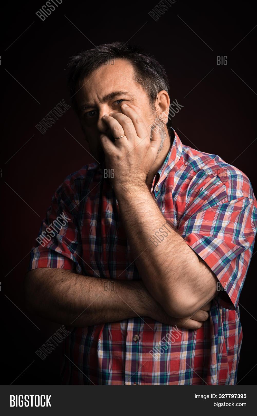 Portrait Of Sick Middle Aged Man.