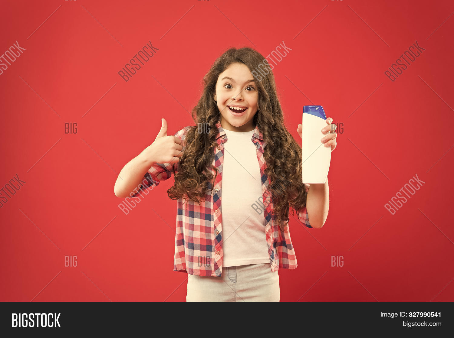 The Best Care Ever. Little Girl Showing Thumbs Up For Hair Care Product On Red Background. Happy Sma