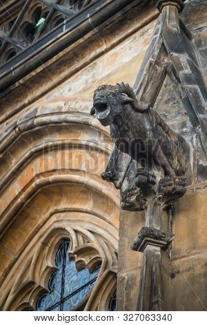 One of gargoyles of St. Vitus cathedral in Prague stock photo