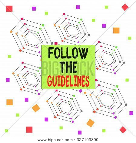 Text sign showing Follow The Guidelines. Conceptual photo Manual of Style Follow a Specified Rule Accordingly Centered Hexagon Concentric Pattern Randomly Scattered Colored Squares. stock photo