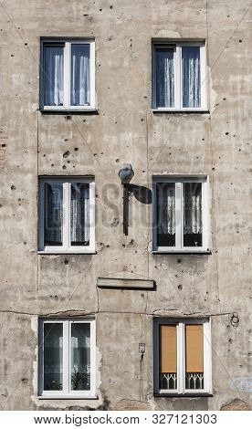 Old tenement in capital of Poland Warsaw in Praga district with second world war marks of shots on its parget stock photo
