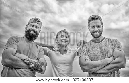 Feel comfortable with friends teammates. Trust and support attributes of true team. Strength in unity. Confident in teammates. Woman and men look confident while stay close each other like team stock photo