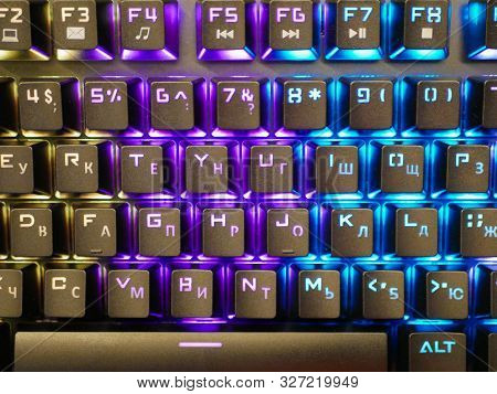 multi-colored keyboard. mechanical keys. Multi-colored professional gaming mechanical rgb keyboard on the table background stock photo