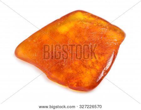 Beautiful orange amber gemstone on white background stock photo