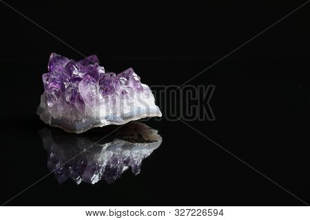 Beautiful purple amethyst gemstone on black background. Space for text stock photo