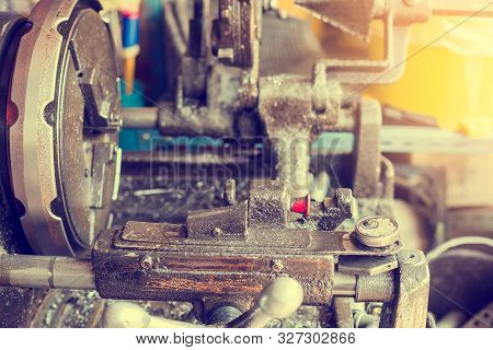 Pipe making by the threading machine. The lathe machine or turning machine cutting the thread at the end of metal pipe or tube. Classic manufacturing process. stock photo