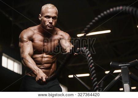 Fitness Athletes Training Using Battle Ropes Intense Workout Team Exercise Challenge In Gym Enjoying