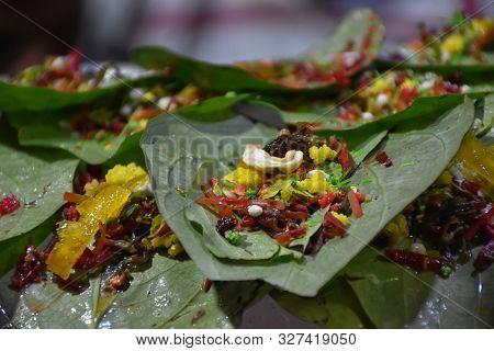 banarasi pan, betel nut garnished with all indian banarasi ingredients for sale (Selective Focus) stock photo