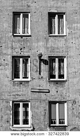 Monochrome image of old tenement in capital of Poland Warsaw in Praga district with second world war marks of shots on its parget stock photo