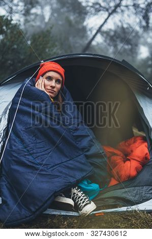 Tourist Traveler Ralaxing In Camp Tent In Froggy Rain Forest, Closeup Lonely Hiker Woman Enjoy Mist