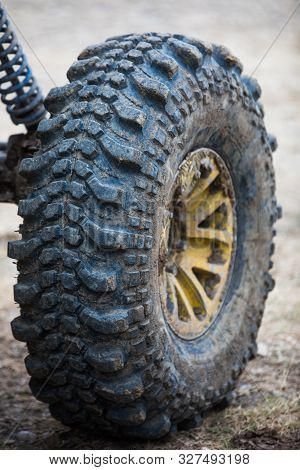 Close up shot of a muddy off road tire on a 4x4 car. stock photo
