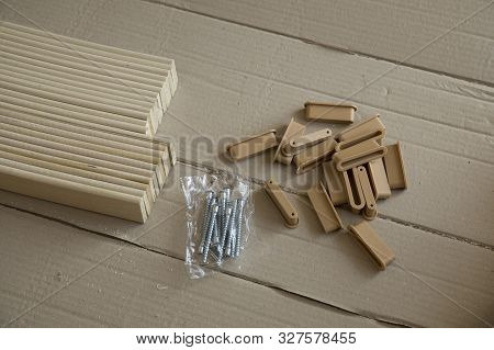 Furniture assembly parts and tools for self assembly furniture, on the floor. stock photo
