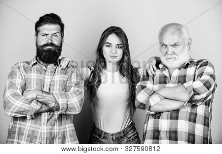 Choosing life partner. Girl pretty adorable woman prefer more experienced partner. Men and female threesome. Relations group people. Senior mature bearded men competitors. She likes mature partner stock photo
