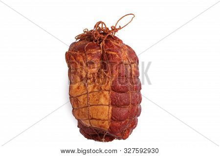 Smoked, boneless pork ham in netting. Cold cuts made of pork meat. Isolated on a white background. stock photo