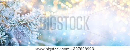 Christmas background. Xmas tree with snow decorated with garland lights, holiday festive background.