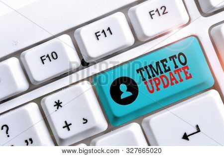 Conceptual hand writing showing Time To Update. Business photo showcasing act updating something someone or updated version program White pc keyboard with note paper above the white background. stock photo