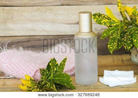 the therapy first serum toners with cotton natural cosmetics extract herbal health care for skin face beauty and knitting wool scarf of lifestyle woman arrangement flat lay style on background wooden stock photo