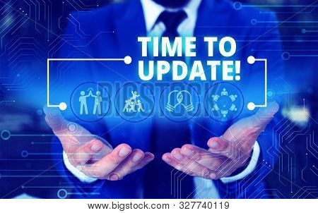 Handwriting text Time To Update. Concept meaning act updating something someone or updated version program Male human wear formal work suit presenting presentation using smart device. stock photo