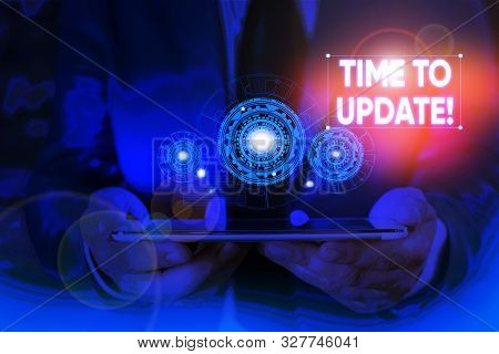 Writing note showing Time To Update. Business photo showcasing act updating something someone or updated version program Male wear formal suit presenting presentation smart device. stock photo