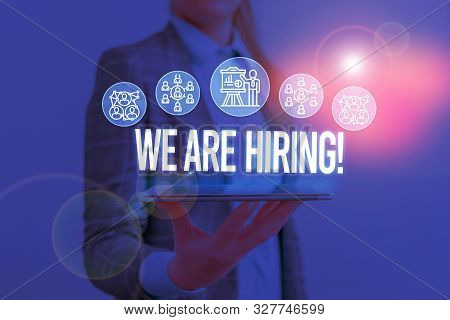 Writing note showing We Are Hiring. Business photo showcasing recently you employ someone or pay someone to do particular job Woman wear formal work suit presenting presentation using smart device. stock photo