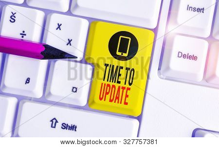Word writing text Time To Update. Business concept for act updating something someone or updated version program White pc keyboard with empty note paper above white background key copy space. stock photo