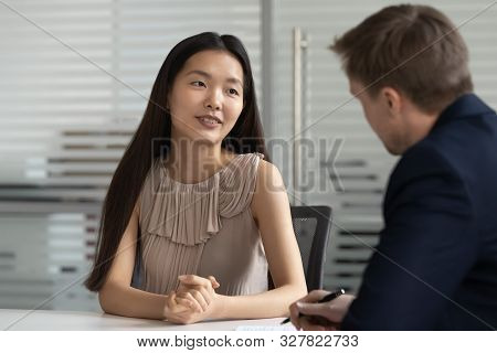 Asian woman vacancy candidate answering question during job interview stock photo
