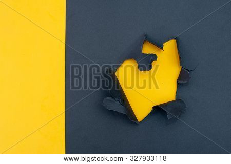 yellow and gray background. Hole on paper stock photo
