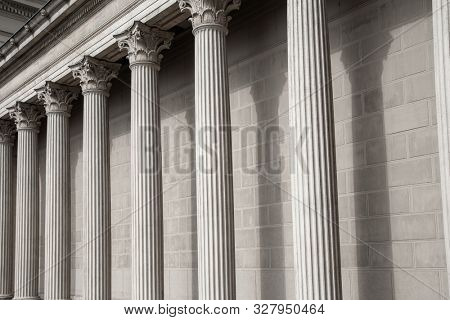 Vintage Old Justice Courthouse Column. Neoclassical colonnade with corinthian columns as part of a public building resembling a Greek or Roman temple stock photo