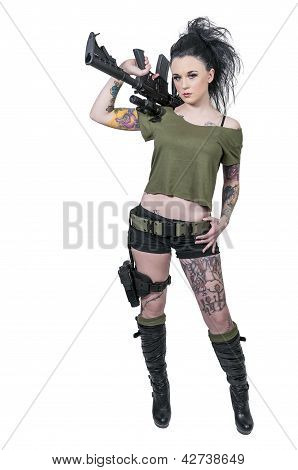Beautiful young woman holding an automatic assault rifle stock photo