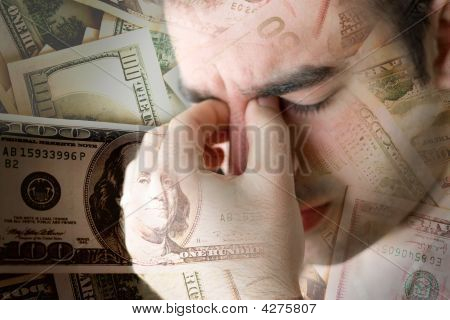 This young man is experience intense stress over a time of economic downturn or other financial hardship. stock photo