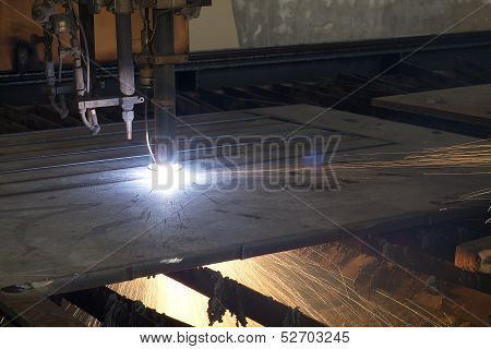 Cutting machine is now cutting the steel plate stock photo