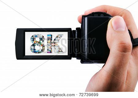 Hand holding Ultra High Definition camcorder isolated on white stock photo