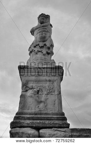 Statue of Triton greek mythology sea god son of Poseidon merman creature half human with fish tail. Ancient agora of Athens Greece. stock photo